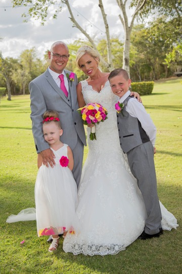 Dreams La Romana- Liz Moore Destination Weddings shows wedding couple and their family