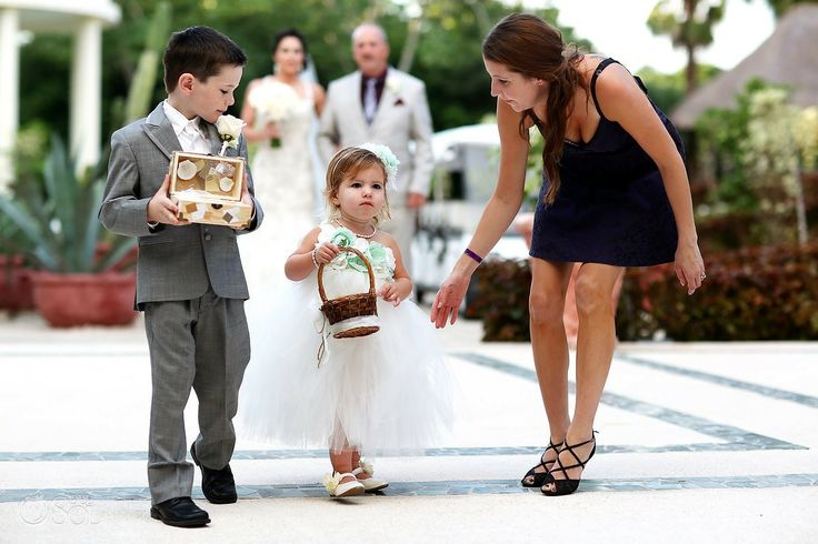 Flower girl getting some help up the aisle