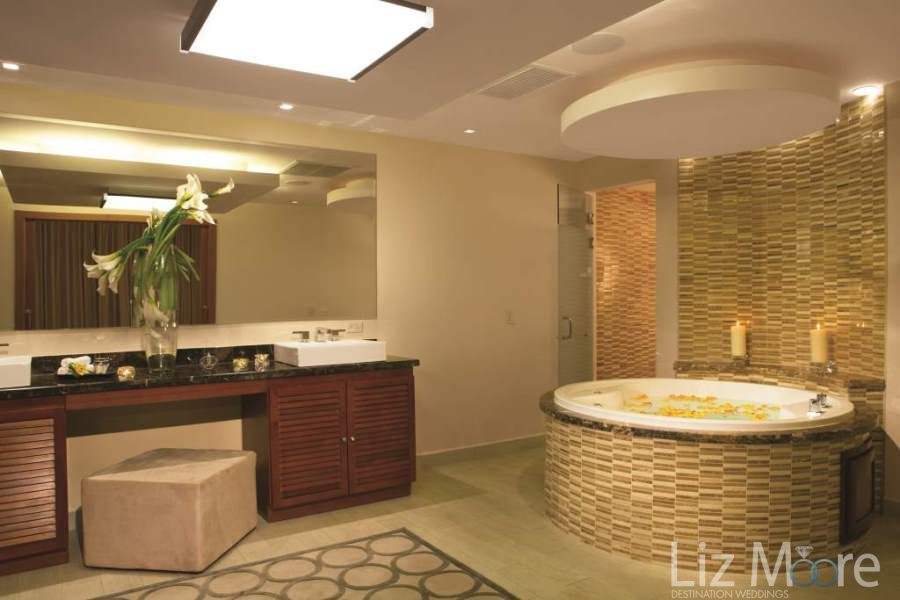 Bedroom bathroom area with deep soaker tub and yellow pot flower petals