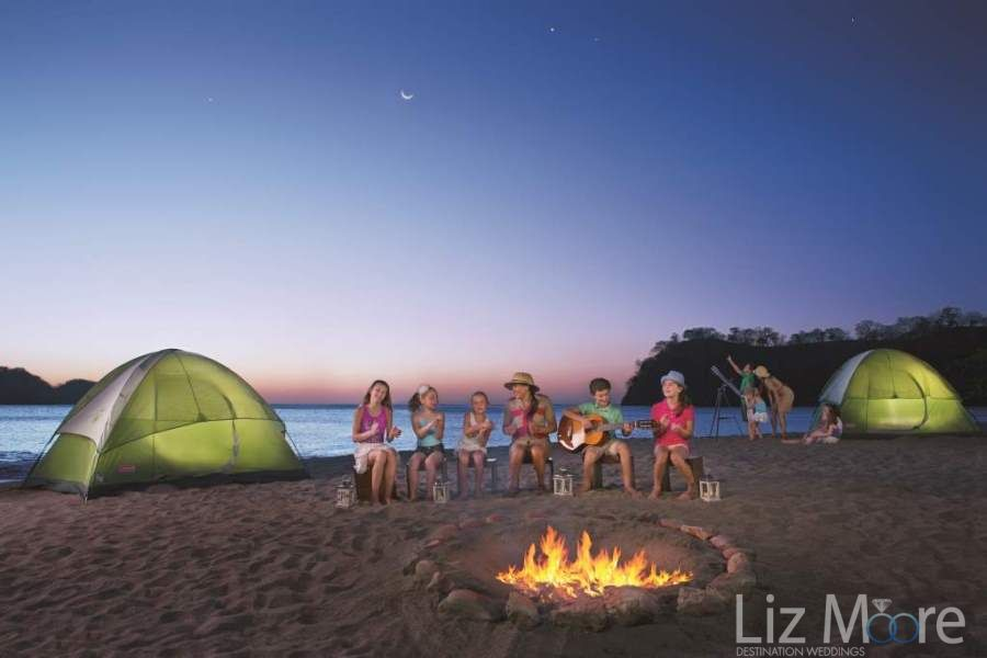 Kids club explorers club with picnics on the beach and fire
