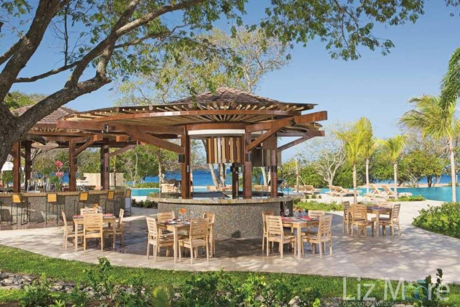 Outdoor beach bar beside the pool with comfortable would share seating