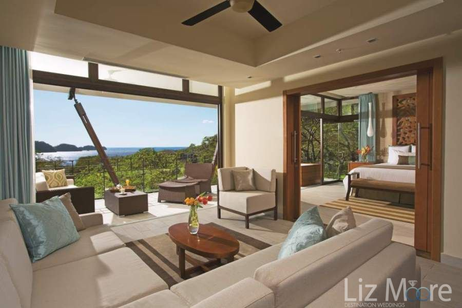 Presidential suite with wide open sitting lounge area and stunning view of the lush jungle and ocean