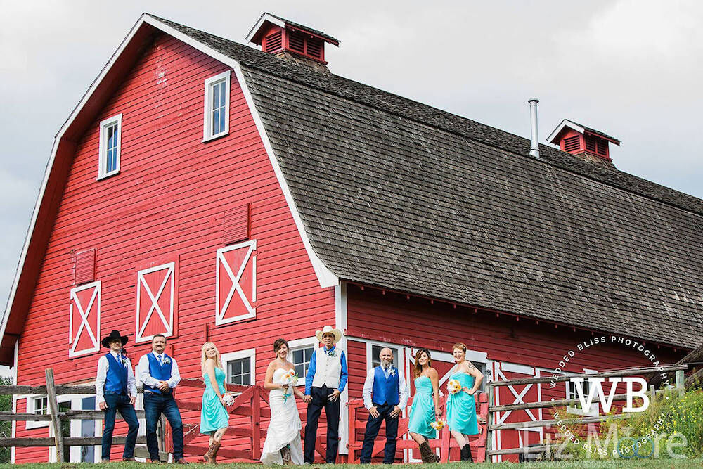 Veron The Red Barn with wedding guests outside red barn
