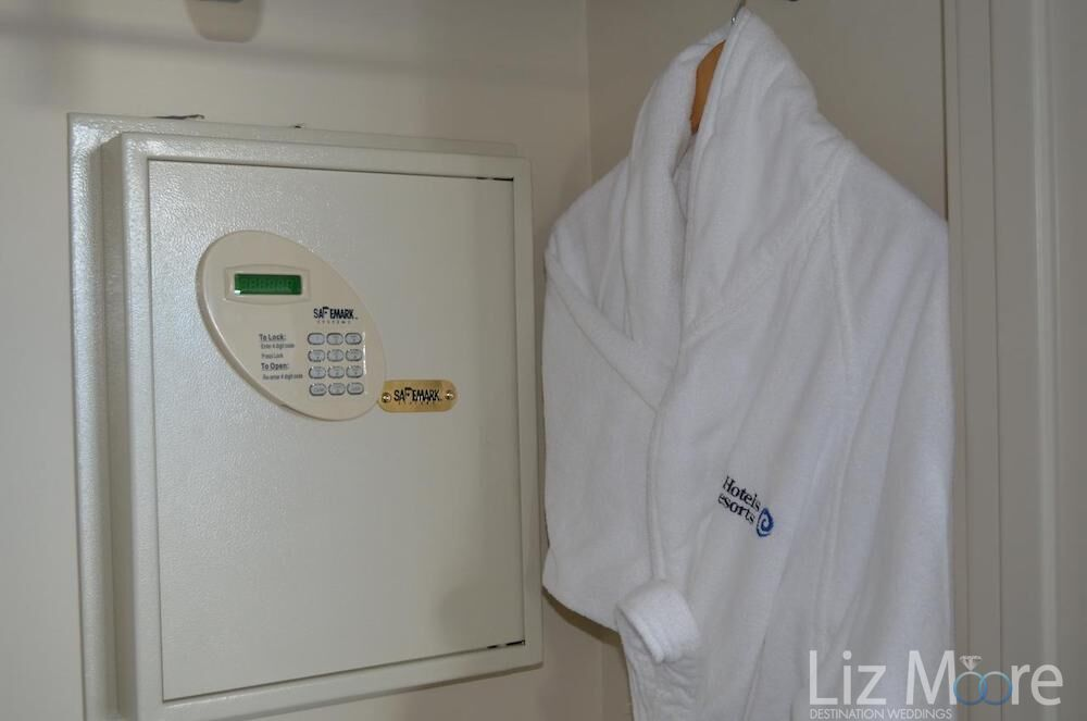 In room safe located in the bedroom as well as logo resort robe