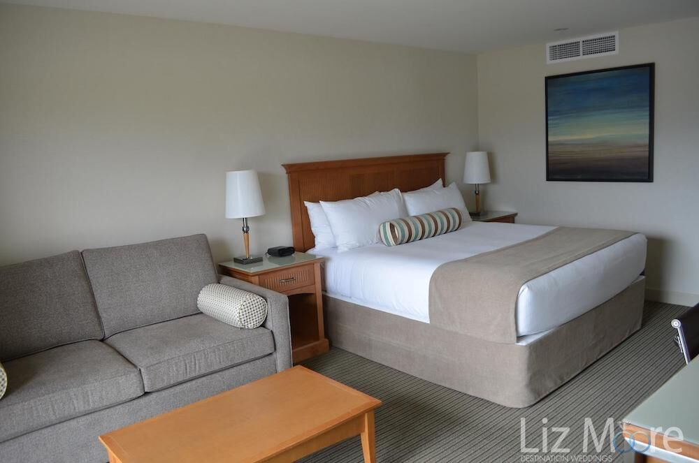 Main view of bedroom with queen bed couch and table area