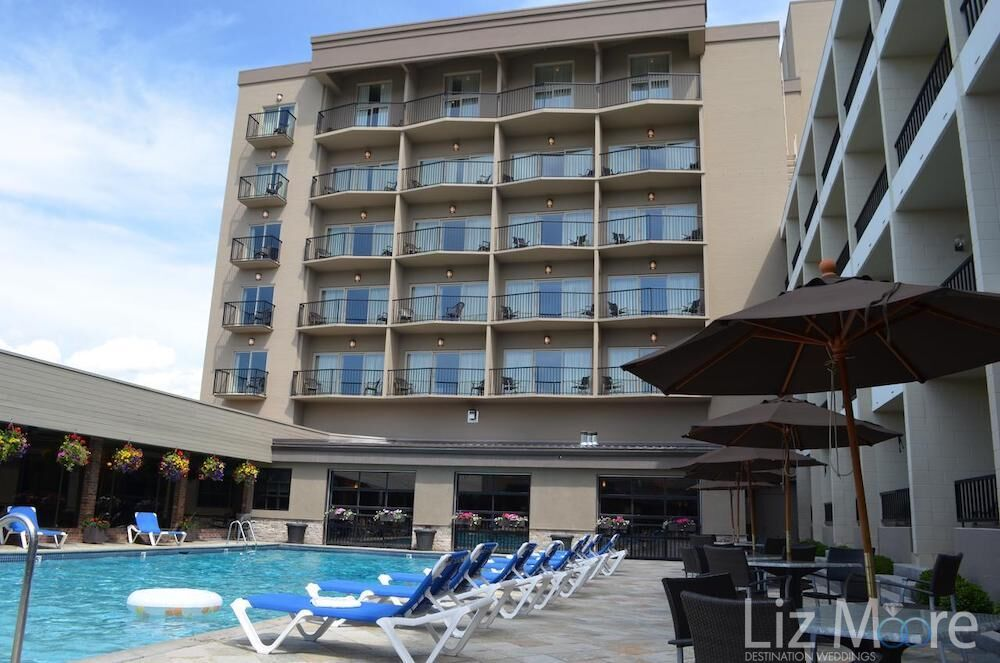 You are the main pool area lounge chairs with bedroom building in the background