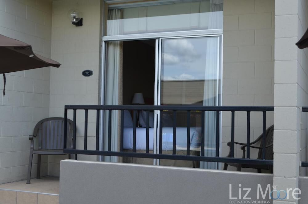 View of the bedroom balcony with railing and two chairs for setting