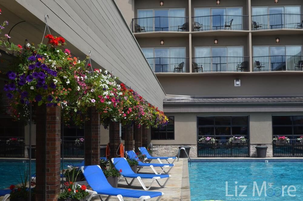Flower beds overlooking the pool lounge chairs beside the main swimming pool