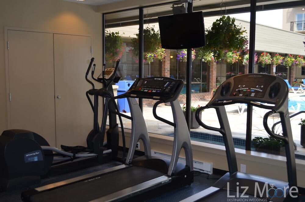 Fitness centre with treadmills and window and front with a view to the pool