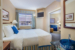 Summerland-Resort-king-bedrom-and-additional-sitting-area