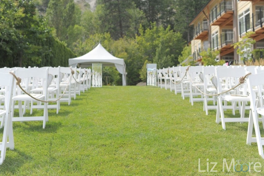 Wedding Ceremony location with gazebo and chairs on the line of the resort