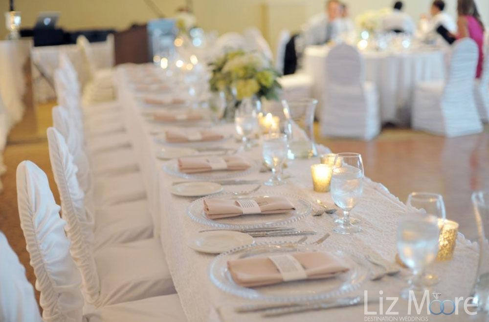 Ballroom wedding reception plates seats and glasses