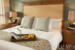 Watermark-Beach-Resort-Hotel-bedroom-with-breakfast-tray