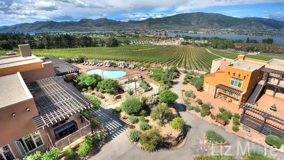 Aerial view of the hotel the main for pathway to the vineyard and lakes and mountains in the background