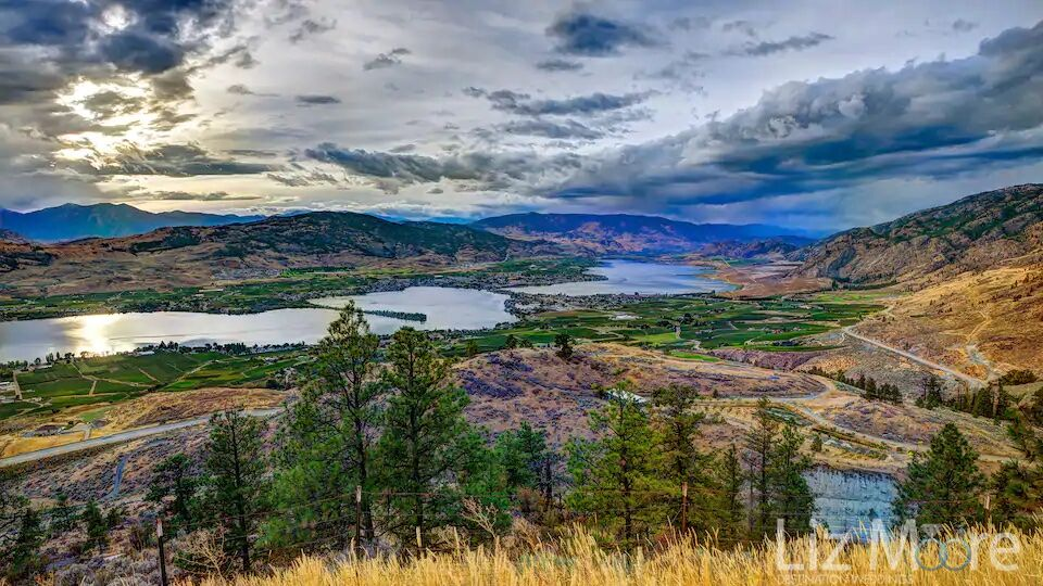 Aerial view of Osoyoos Lake as well as the mountains and vineyards
