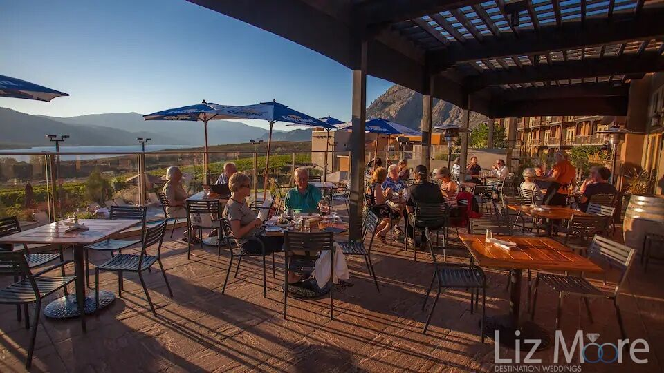 Outdoor patio area with gas dining and looking at a Osoyoos lake