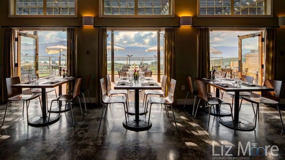 Main restaurant and dining area with outdoor patio deck and beautiful views of the lake and mountains