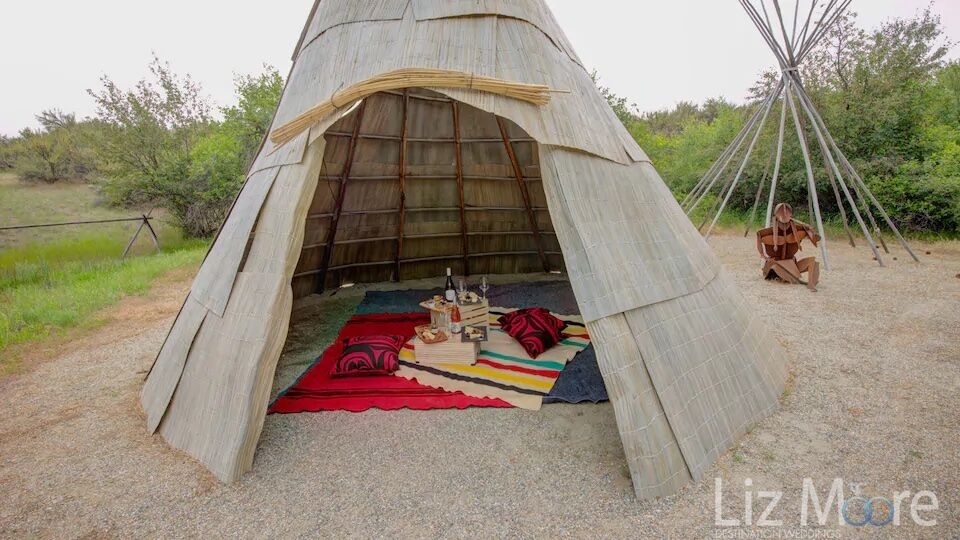 TeePee located on resort reserved for picnic with wine and food inside