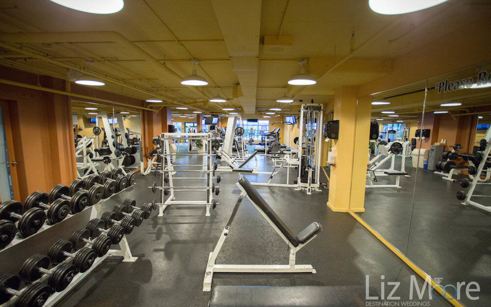 fitness center with weights, workout machines and mirrors