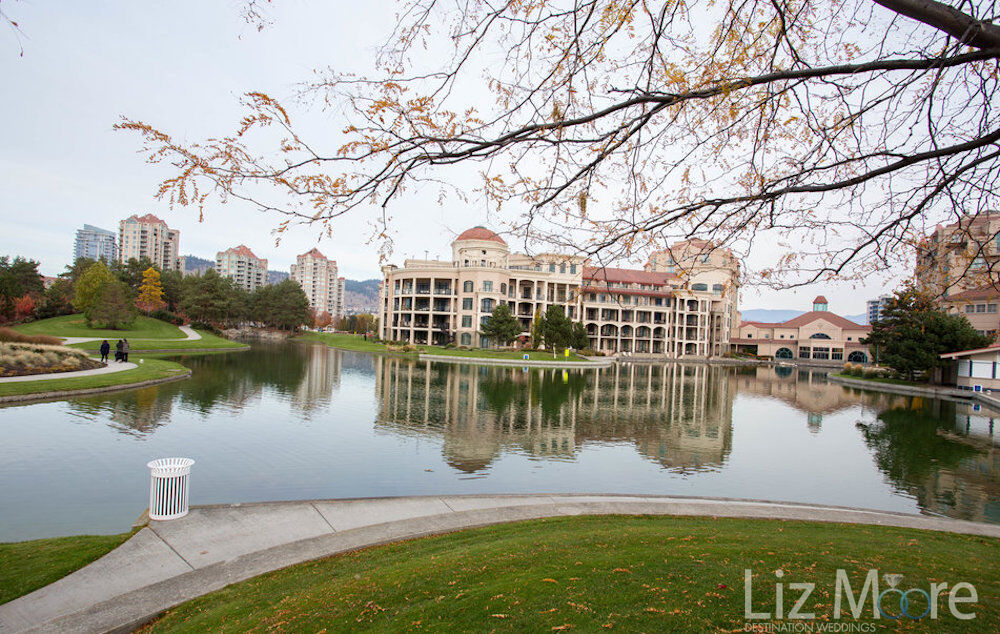 Outdoor area with resort in the background Beautiful lake water and pathways with trees