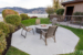 The-Cove-Lakeside-Resort-outdoor-firepit-with-table-and-chairs