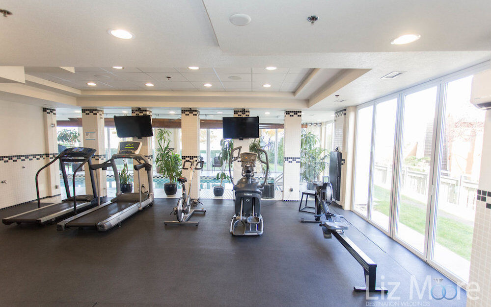 fitness centre with the treadmills bike machines and rowing machine