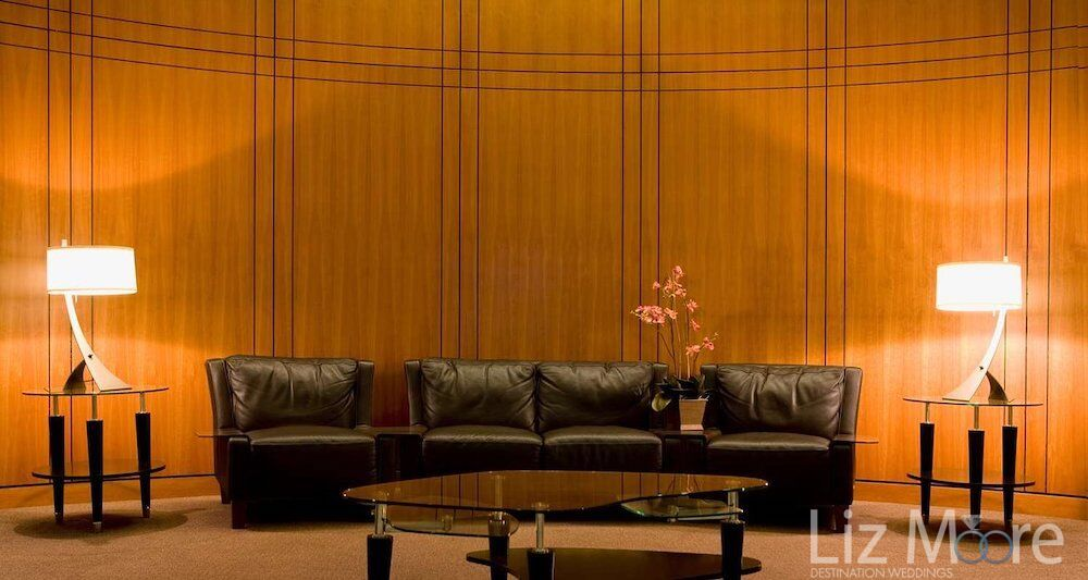 brown leather lobby couch located in the main reception area