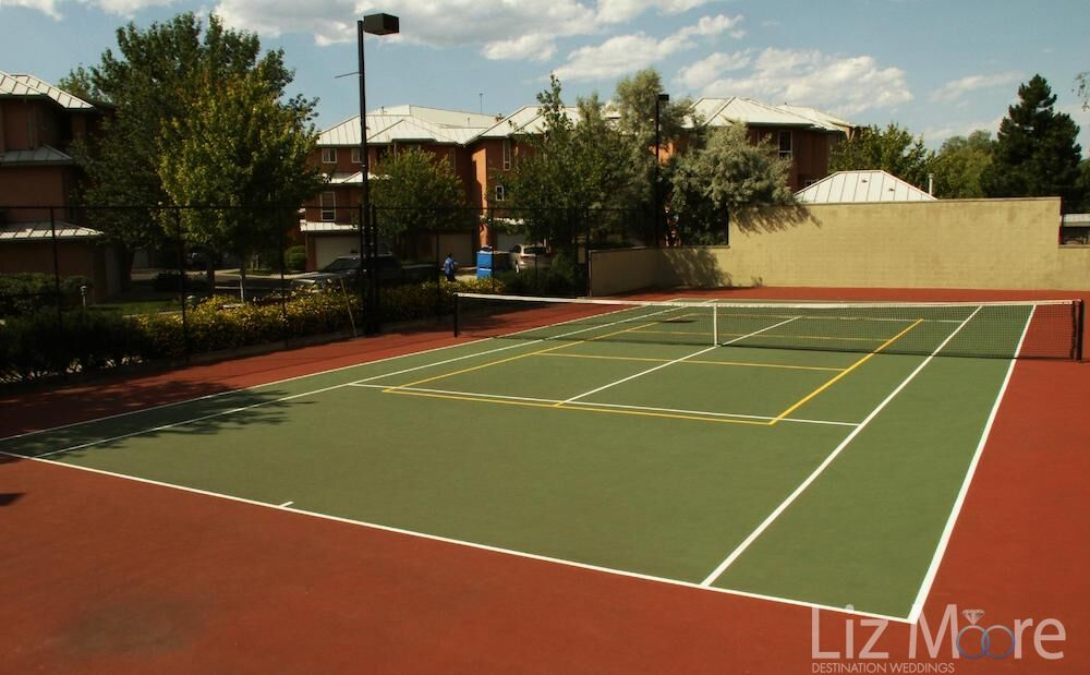 Tennis court located beside the property with the lights for playing in the evening