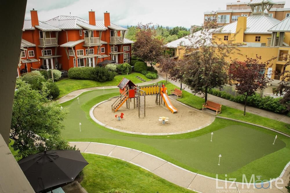 Aerial view of children's play area located in the inner centre of the resort surrounded by a putting green