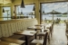Mateo-Waterfront-Resort-&-Villas-seating-in-dining-room-with-lakeview
