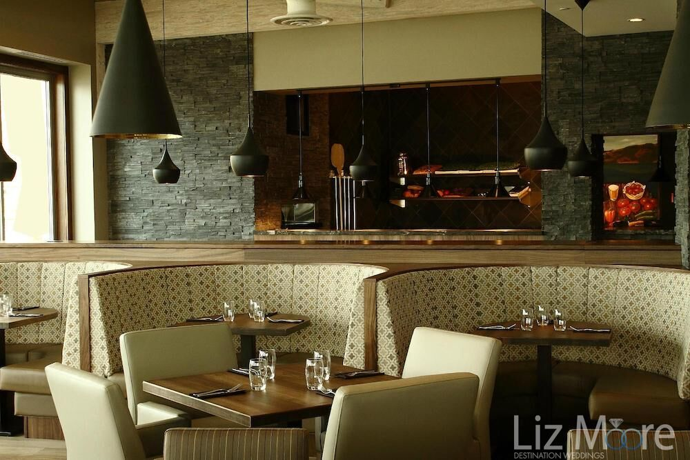 Decorative bench seating with tables and chairs in the main dining room