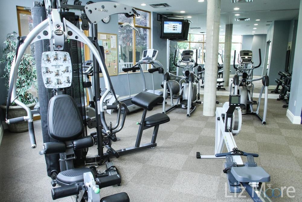 Fitness centre with a workout machine is weights and treadmills