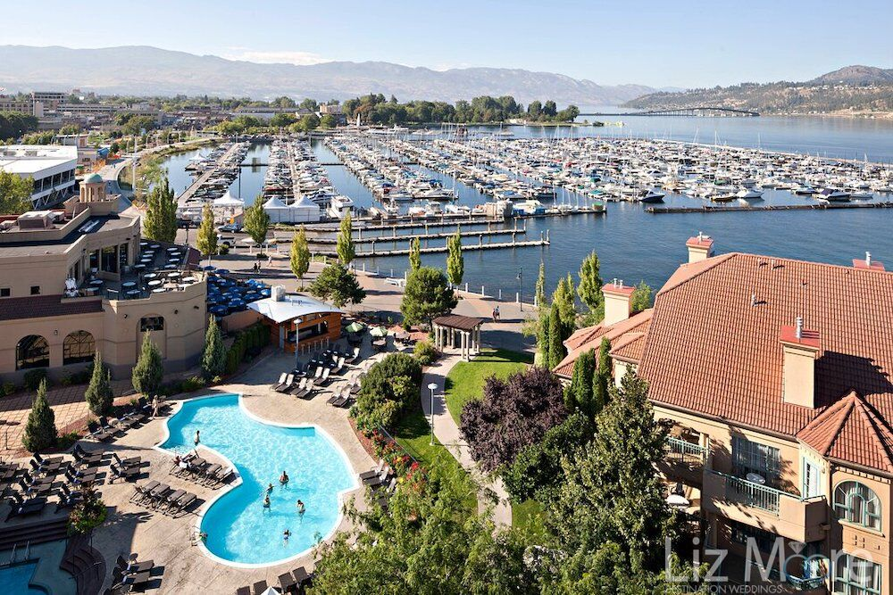 Aerial view of resort oh outdoor pool along with Marina mountains and like