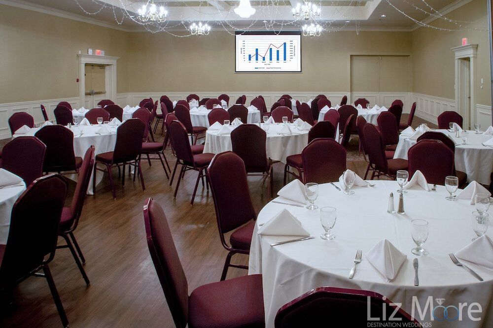 indoor ballroom table and chair set up for indoor wedding reception