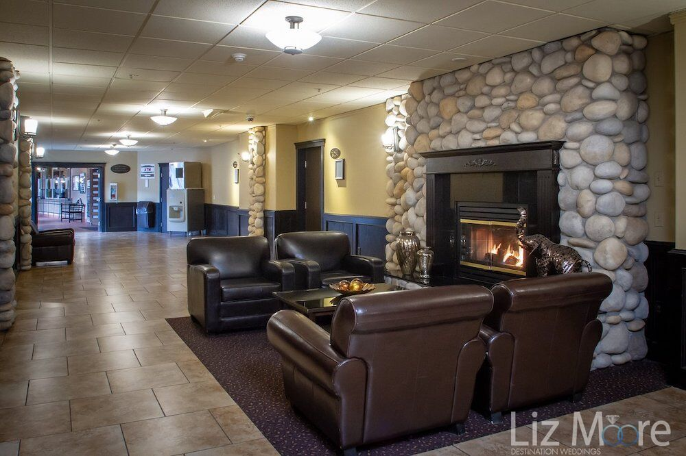 hotel lobby lounge seating area with leather couches and stone fireplace