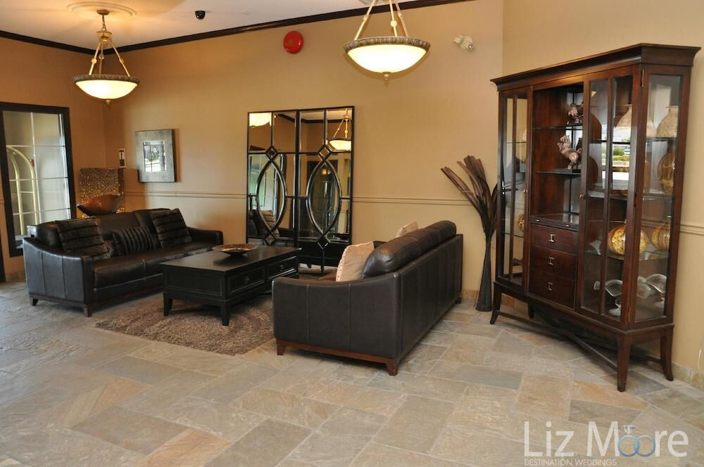 hotel lobby seating area with leather couches and marble flooring