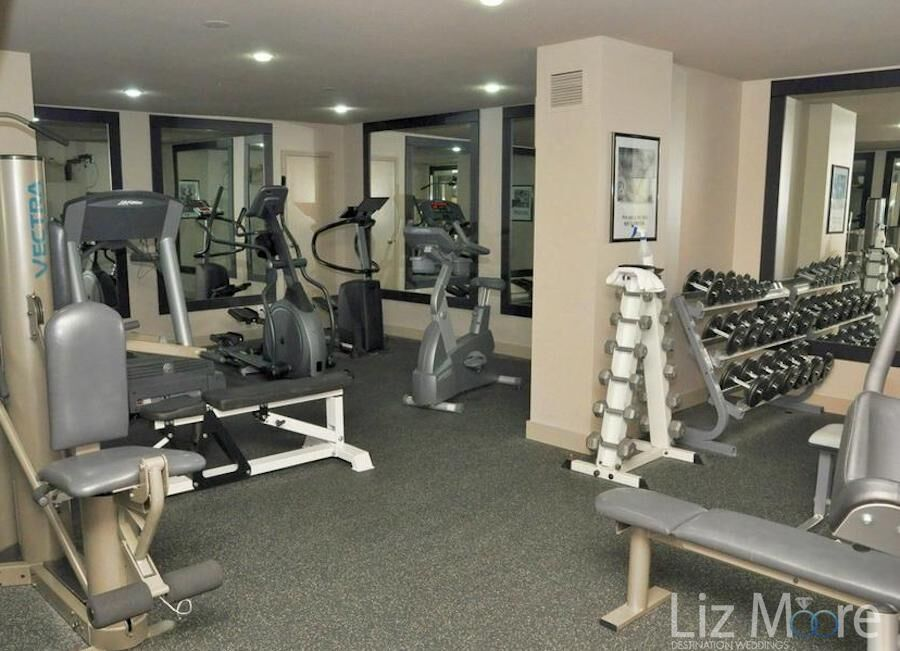 hotel fitness room with weights, treadmills and bikes
