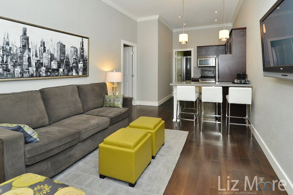 couch area of bedroom with kitchenette and bar seating