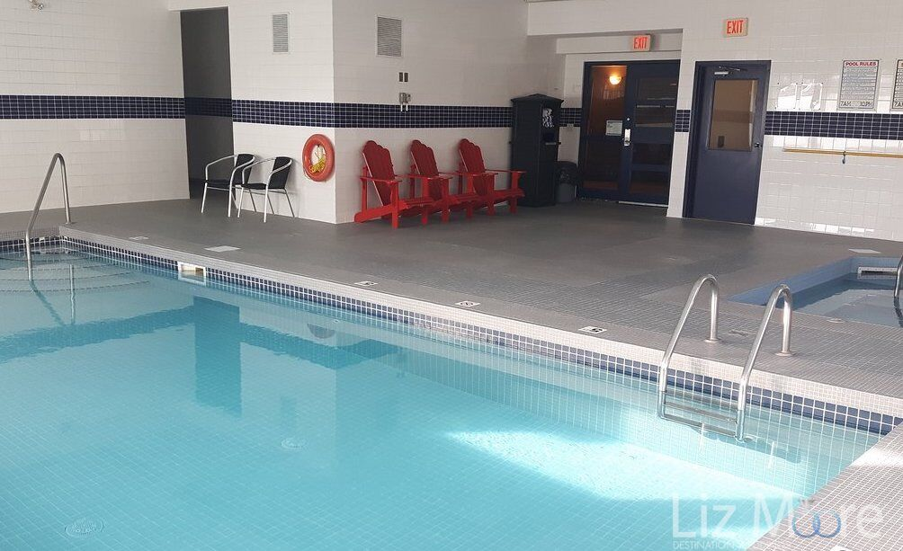 main swimming pool along with red lounge chairs