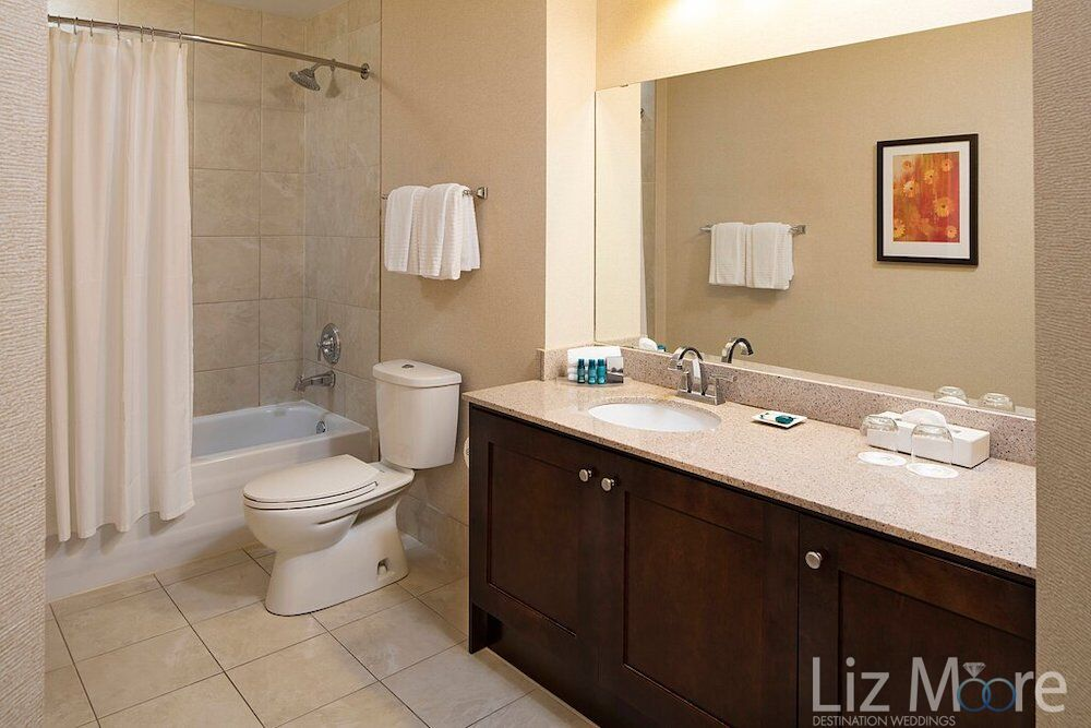 Two bedroom Condo bathroom with vanity sink towels Picture and shower and tab