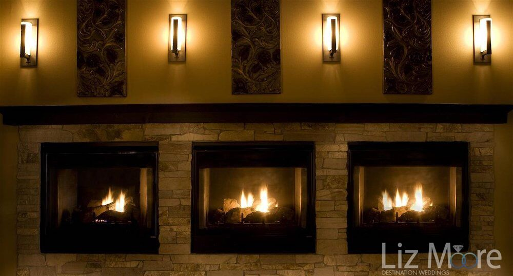 vintner poolside grill fireplaces in the evening with scone lighting above
