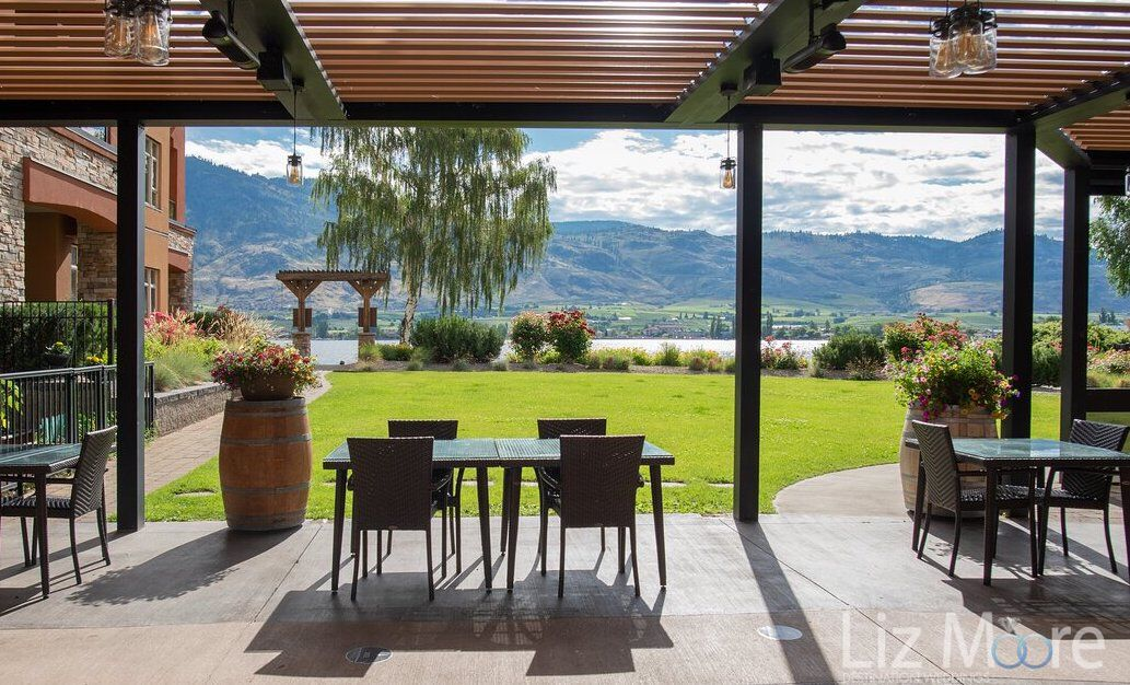 outdoor patio dining area with wine barrels and in view of the gardens and leak in the background