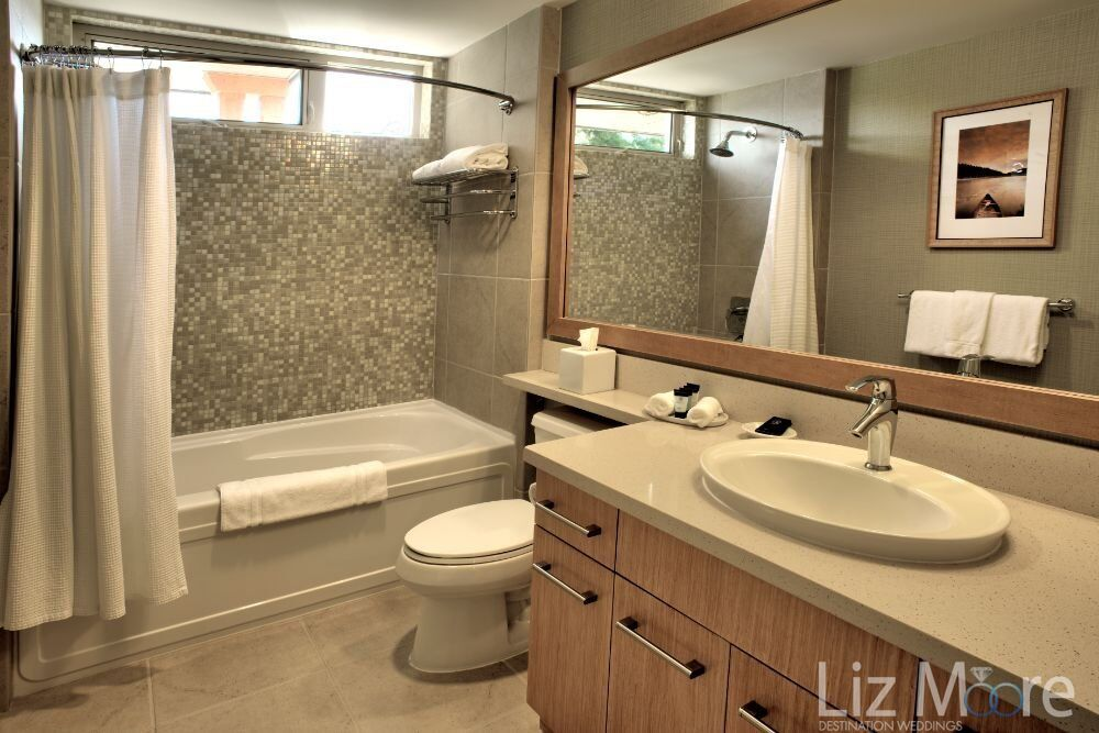 suite bedroom bathroom with large soaker tab vanity sink and are manatees