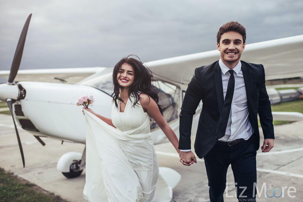 Engaged couple heading to their destination wedding